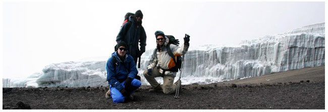 climbing Kilimanjaro with tour guide